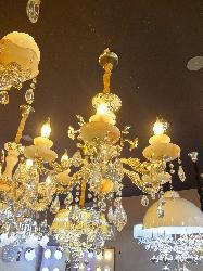 Shiny Flowers in Metal with Six Candle Chandelier